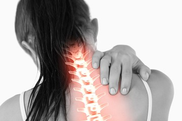 Highlighted spine of woman with neck pain