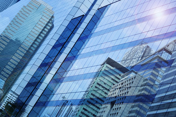 Fototapete - Reflect of modern city building on window glass tower, Bangkok T