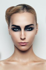blond woman with black eyeshadows