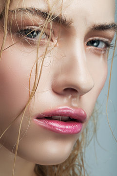 wet blond woman with pink lips