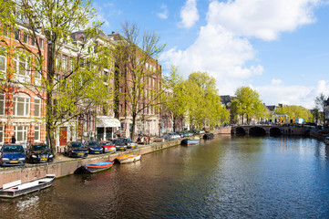 Amsterdam canal, boats along the bank of the river. Netherlands.
