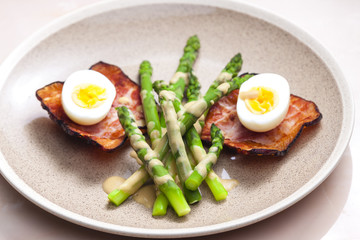 boiled green asparagus with bacon, egg and mustard dip
