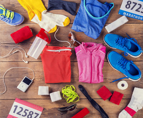 Running equipment composition. Studio shot on wooden background.