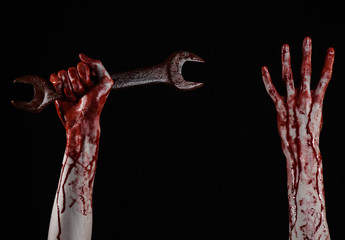 bloody hand holding a big wrench, bloody wrench, big key
