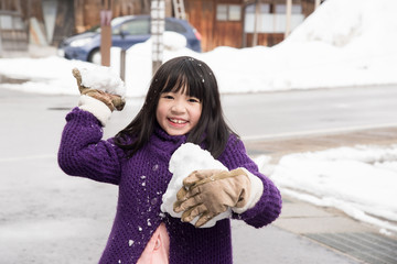 Cute asian girl smiling outdoors in snow