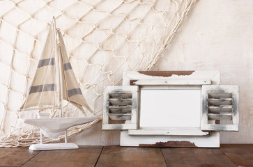old vintage wooden white frame and sailing boat