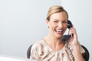 Woman Using Telephone