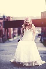 Bride standing in street