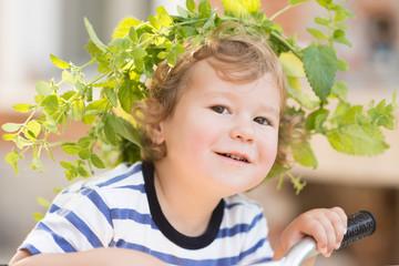 USA, South Carolina, Greenville County, Greenville, Portrait of boy (2-3) wearing wreath