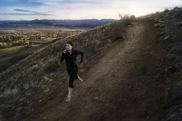 USA, Colorado, Jeferson County, Golden, Woman running along hillside earth road