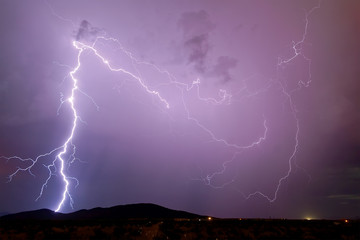 USA, Arizona, Maricopa County, Arlington, Thunder bolt over Scar Hill
