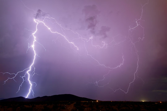 USA, Arizona, Maricopa County, Arlington, Thunder bolt over Scar Hill