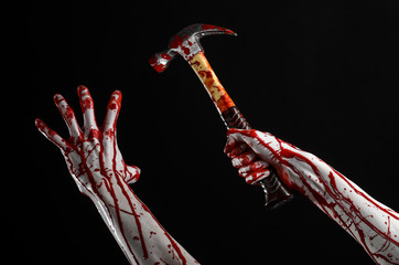 bloody hand holding bloody hammer isolated on black background