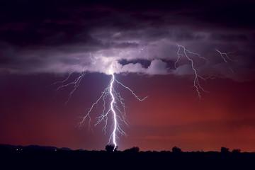 Lightning in sky at night