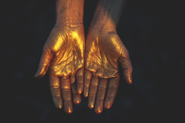 Close-up of woman's hands in cold color