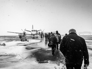 Sweden, Kalmar, Kalmar Airport, Passengers boarding small airplane in winter