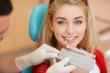 Deantist woman teeth whitening dental clinic