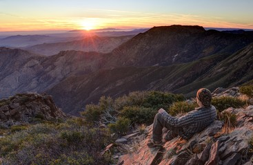 USA, California, Cleveland National Forest, Hiker looking at sunrise