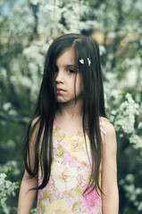 Portrait of a girl with blossom in her hair