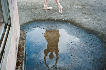 Reflection of a ballerina in a puddle, Okinawa, Japan