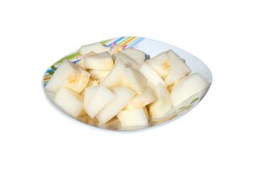 Ein Teller geschnittene Zuckermelonenstücke