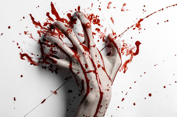 bloody hand print on a white leaves bloody wall studio isolated