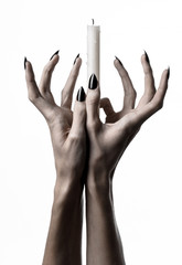 hands holding a candle, a candle is lit, white background