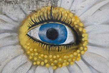 Grafitti einer Sonne mit Auge