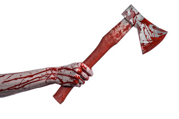 bloody hand holding a bloody butcher's ax isolated in studio