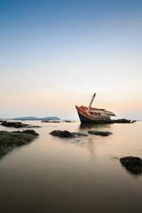 Acrylic Prints Shipwreck An old fishing boat wreck near the coast.