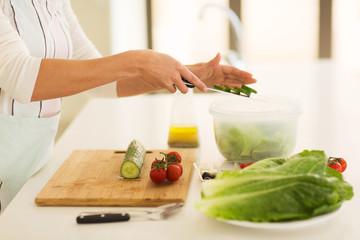 woman making vegetable salad