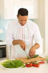 middle aged man preparing diner