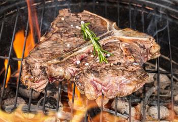 Delicious t-bone steak on fire