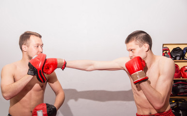 male kick boxer exercising with his instructor
