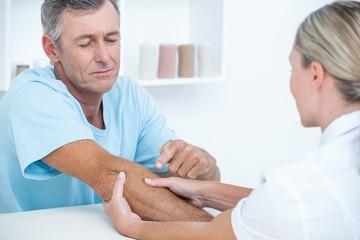 Doctor doing arm massage