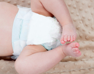 Legs of a baby with diaper