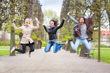 Group of women jumping at park