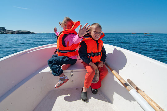Smiling kids on the boat
