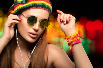 Beautiful Party Girl Enjoying Music Through Headphone