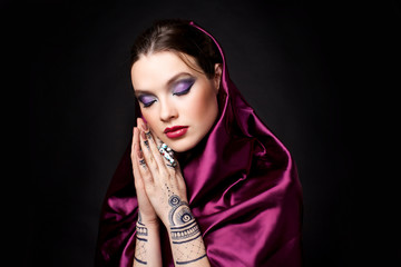 beautiful woman in oriental style with mehendi in hijab