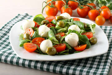 Caprese salad tomato, mozzarella and olives