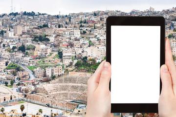 tourist photographs skyline of Amman city, Jordan
