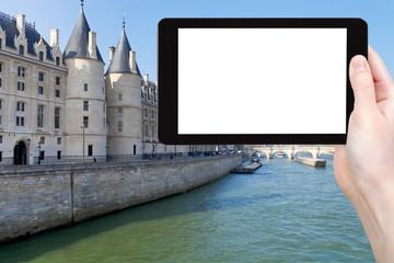 tourist photographs Conciergerie palace in Paris