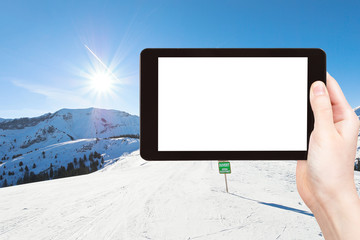 photo of skiing tracks on snow slopes in sunny day