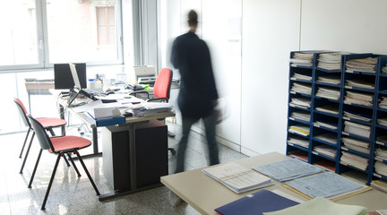 Man moving in a little office