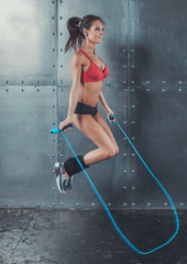 Sporty woman jumping skipping rope concept sport health fitness