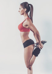 Portrait of muscular active athlete woman standing looking