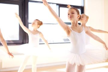 Graceful young ballerinas practising a ballet