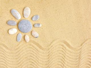 Stones arranged like a sun on the beach