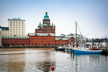 Uspenski cathedral and boats in harbor of Helsinki, Finland